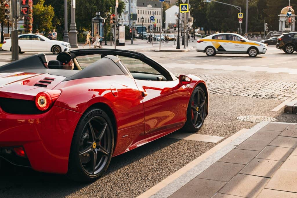 red convertible in the street